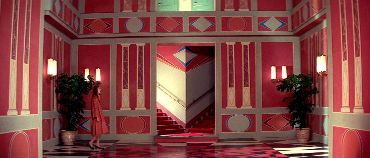 Red / tan hallway scene from Suspiria